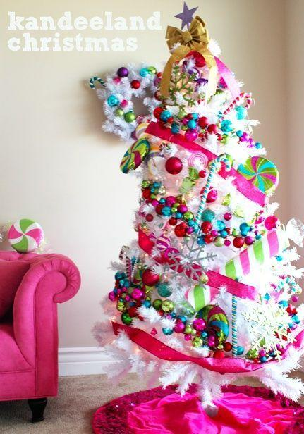 """<p>A sweets-themed tree comes to life with vibrant blue, green, and pink ornaments, which really pop against faux white needles. </p><p><em><a href=""""http://www.kandeej.com/2011/12/my-candyland-or-kandeland-holiday-house.html"""" rel=""""nofollow noopener"""" target=""""_blank"""" data-ylk=""""slk:Get the tutorial at Kandee Johnson »"""" class=""""link rapid-noclick-resp"""">Get the tutorial at Kandee Johnson »</a></em></p>"""