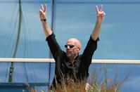 U.S. actor Bruce Willis gestures before a photocall for directors Karey Kirkpatrick and Tim Johnson's out of competition animated film 'Over the Hedge' at the 59th Cannes Film Festival May 21, 2006. REUTERS/Tom Boland