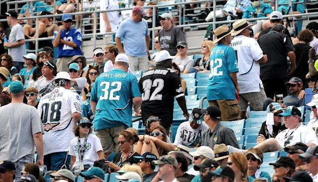 Fans leave at the end of the third quarter of the Jacksonville Jaguars 37-3 loss to the Indianapolis Colts in an NFL game in Jacksonville, Fla., Sunday, Sept. 29, 2013. (AP Photo/The Florida Times-Union, Bruce Lipsky )