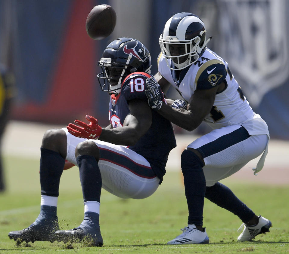 Los Angeles Rams cornerback Blake Countess, right, breaks up a pass intended for Houston Texans wide receiver Sammie Coates during the first half in an NFL preseason football game Saturday, Aug. 25, 2018, in Los Angeles. (AP Photo/Mark J. Terrill)