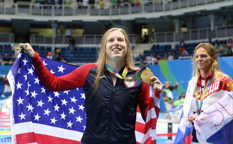 Lilly King celebrates her win in the 100-meter breaststroke on Monday. (AP)