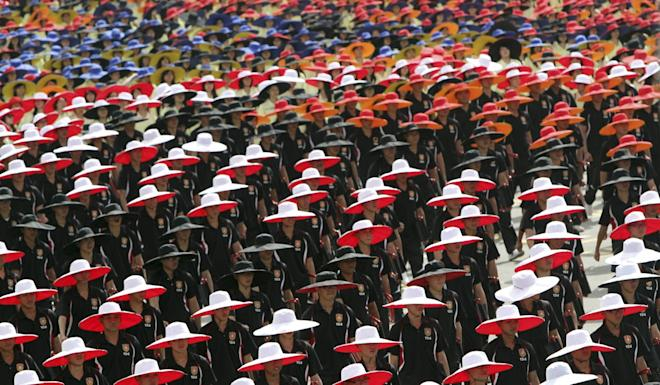 Taiwanese students in coordinated colours march during the 2013 parade. Photo: AP