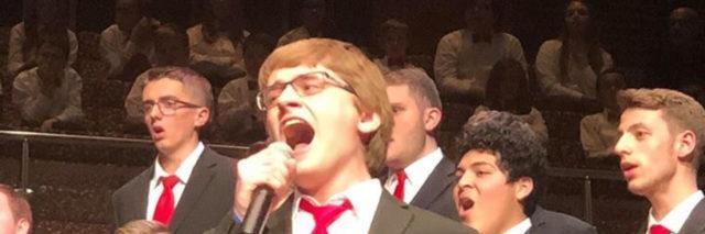 """Ryan singing his heart out at his Chorale performance in November. This is a time where you can ABSOLUTELY shout the word """"better,"""" like, """"Ryan is a much better singer than his mom."""""""