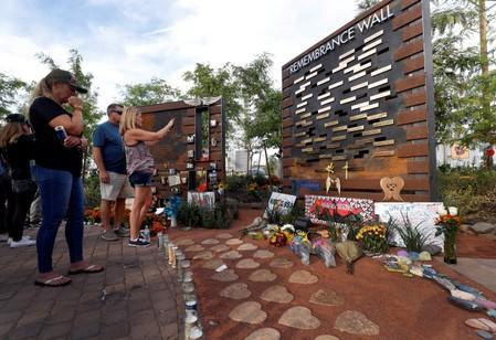 FILE PHOTO: People look over a Remembrance Wall at the Las Vegas Healing Garden during the one-year anniversary of the October 1 mass shooting in Las Vegas