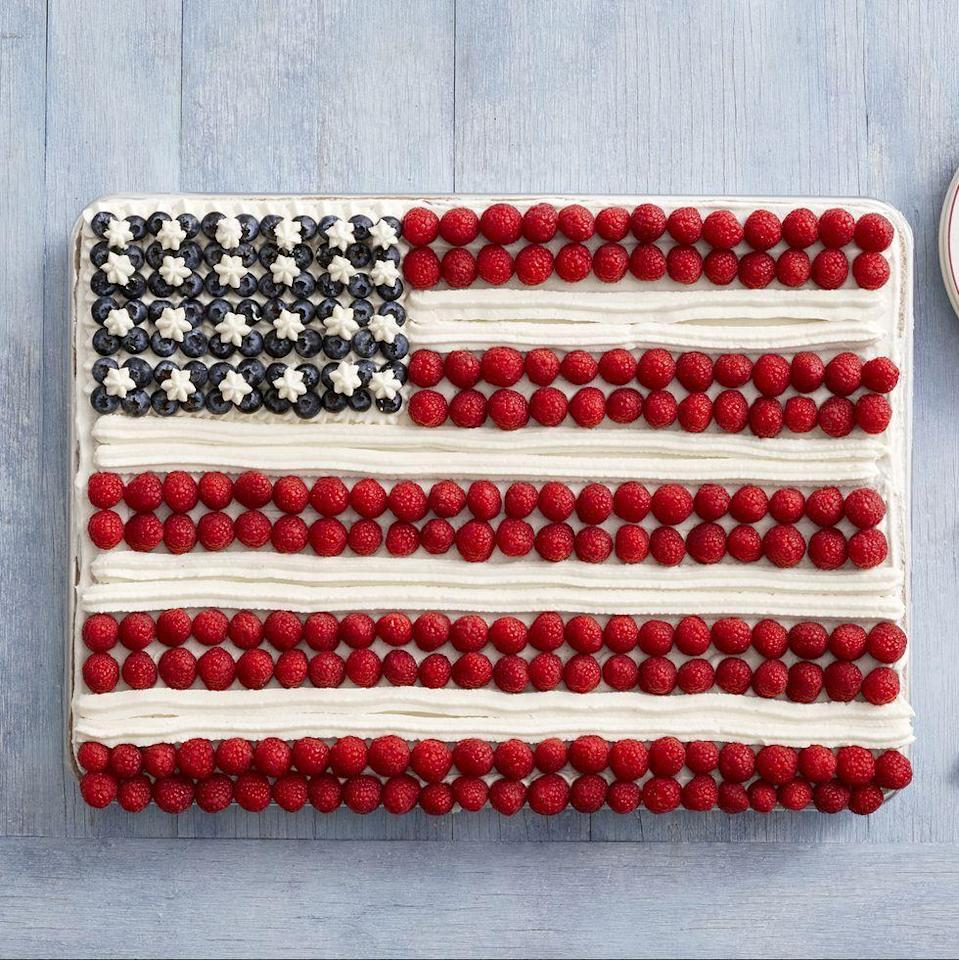"""<p>This 4th of July cake is the ultimate traditional Independence Day dessert, and filled with delicious berries.</p><p><strong><em>Get the recipe at </em></strong><a href=""""https://www.thepioneerwoman.com/food-cooking/recipes/a11633/fourth-of-july/"""" rel=""""nofollow noopener"""" target=""""_blank"""" data-ylk=""""slk:The Pioneer Woman."""" class=""""link rapid-noclick-resp""""><em><strong>The Pioneer Woman.</strong></em></a></p>"""