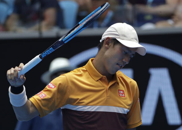 Japan's Kei Nishikori reacts after losing a point to Poland's Kamil Majchrzak during their first round match at the Australian Open tennis championships in Melbourne, Australia, Tuesday, Jan. 15, 2019. (AP Photo/Mark Schiefelbein)