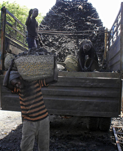 "In this photo of Tuesday Oct. 30, 2012, Somali porters offload charcoal from a truck at a charcoal market in Mogadishu, Somalia. Thousands of sacks of dark charcoal sit atop one another in Somalia's southern port city of Kismayo, an industry once worth some $25 million dollar a year to the al-Qaida-linked insurgents who controlled the region. The good news sitting in the idle pile of sacks is that al-Shabab militants can no longer fund their insurgency through the illegal export of the charcoal. Kenyan troops late last month invaded Kismayo and forced out the insurgents, putting a halt to the export of charcoal, a trade the U.N. banned earlier this year in an effort to cut militant profits. The loss of the charcoal trade ""will cut a major source of revenue and thus will have a detrimental effect on their operational capacity to carry out large scale attacks,"" Mohamed Sheikh Abdi, a Somali political analyst, said of al-Shabab. But the flip side to the charcoal problem is that residents who made their living from the trade no longer are making money, a potentially tricky issue for the Kenyan troops who now control the region. (AP Photo/Farah Abdi Warsameh)"