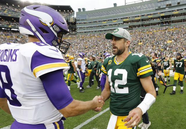 Green Bay Packers' Aaron Rodgers talks to Minnesota Vikings' Kirk Cousins after a game earlier this season. (AP Photo/Mike Roemer)