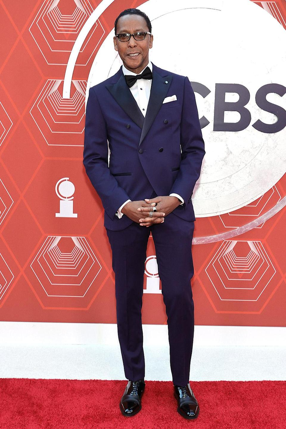 <p>The <em>This Is Us </em>actor wears a navy blue tux by Luigi Bianchi Mantova Flirt to present the first award of the evening. </p>