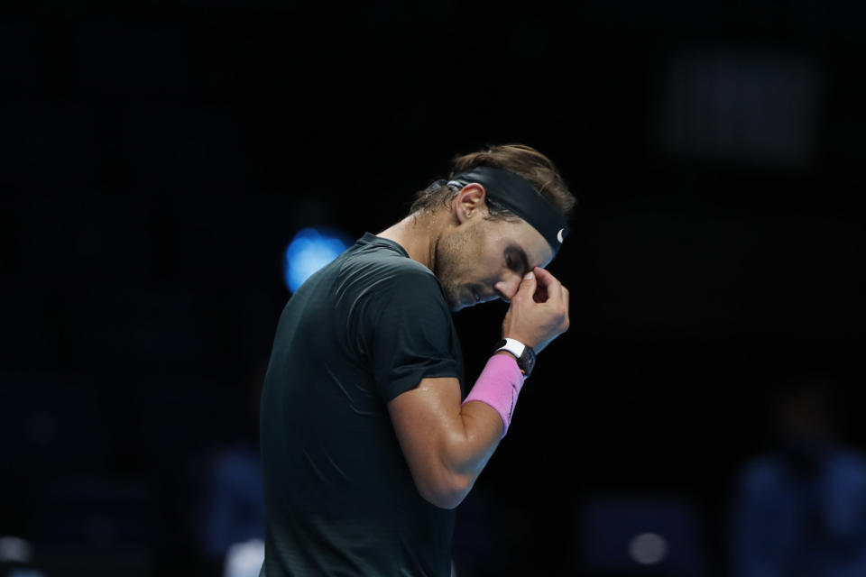 Rafael Nadal of Spain reacts during the semifinal match against Daniil Medvedev of Russia at the ATP World Finals tennis tournament at the O2 arena in London, Saturday, Nov. 21, 2020. (AP Photo/Frank Augstein)