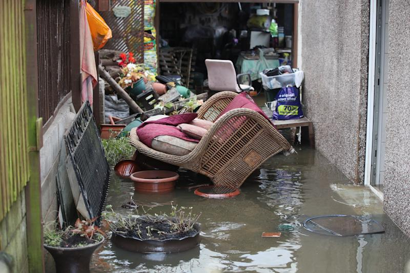 Belongings sit in floodwater outside a house in Fishlake, Doncaster. The Prime Minister is set to chair a meeting of the Government's emergency committee after severe flooding in parts of the country, where rain is finally expected to ease this afternoon.