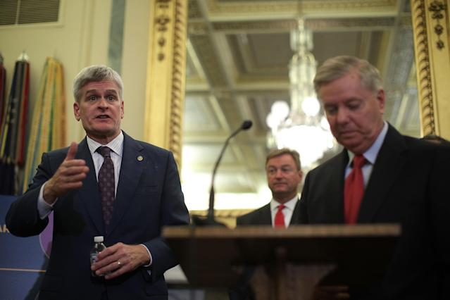 Sen. Bill Cassidy, R-La., speaks as Sen. Dean Heller, R-Nev., and Sen. Lindsey Graham, R-S.C., listen during a recent news conference on health care. (Photo: Alex Wong/Getty Images)