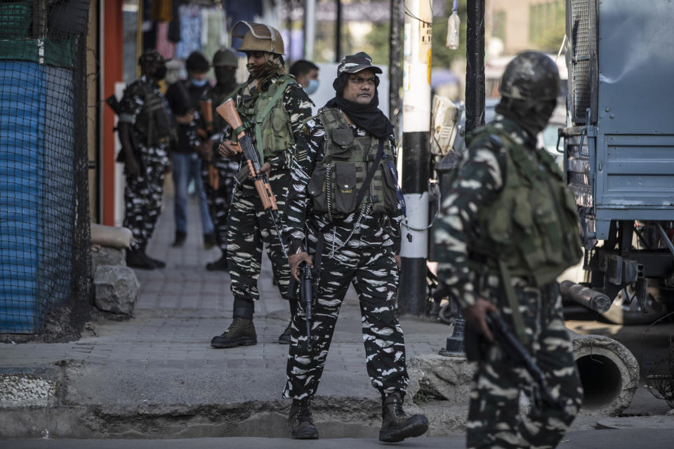 Indian paramilitary soldiers patrol a street in Srinagar, Indian controlled Kashmir, Tuesday, Aug. 24, 2021. Indian government forces killed two senior rebel commanders and three other militants in two separate counterinsurgency operations in disputed Kashmir, police said Tuesday. (AP Photo/Mukhtar Khan)