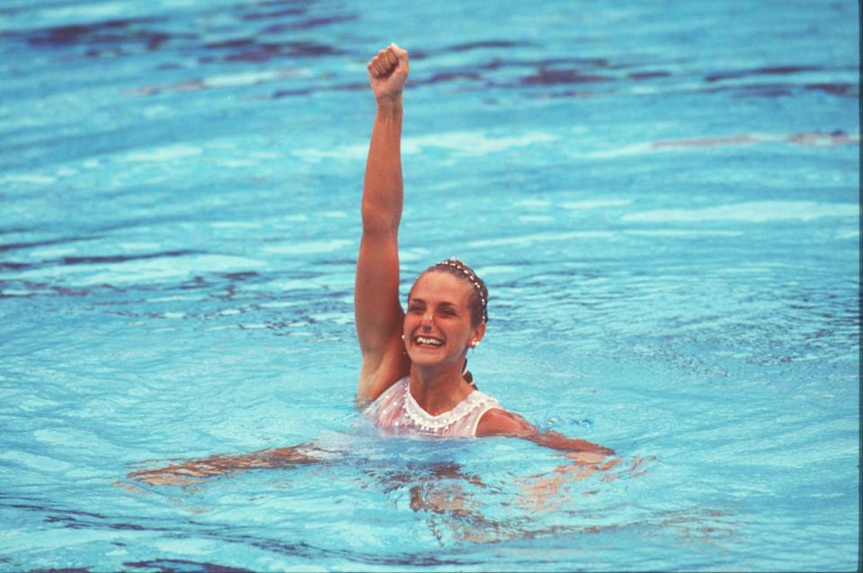 Sylvia Frechette of Canada celebrates after her silver medal performance in the solo discipline portion of Synchronize swimming during the 1992 Barcelona Olympic Games in Barcelona, Spain. (Getty Images)