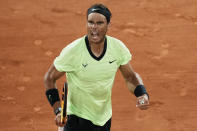Spain's Rafael Nadal celebrates winning a point as he plays Serbia's Novak Djokovic during their semifinal match of the French Open tennis tournament at the Roland Garros stadium Friday, June 11, 2021 in Paris. (AP Photo/Thibault Camus)