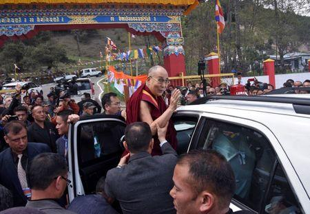 Tibetan spiritual leader the Dalai Lama waves as he leaves Jangchub Chorten in Tawang in the northeastern state of Arunachal Pradesh, India, April 9, 2017. REUTERS/Anuwar Hazarika