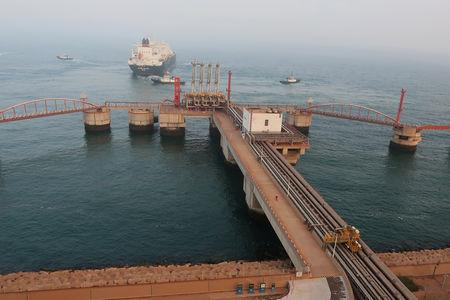FILE PHOTO: A liquified natural gas (LNG) tanker leaves the dock after discharge at PetroChina's receiving terminal in Dalian
