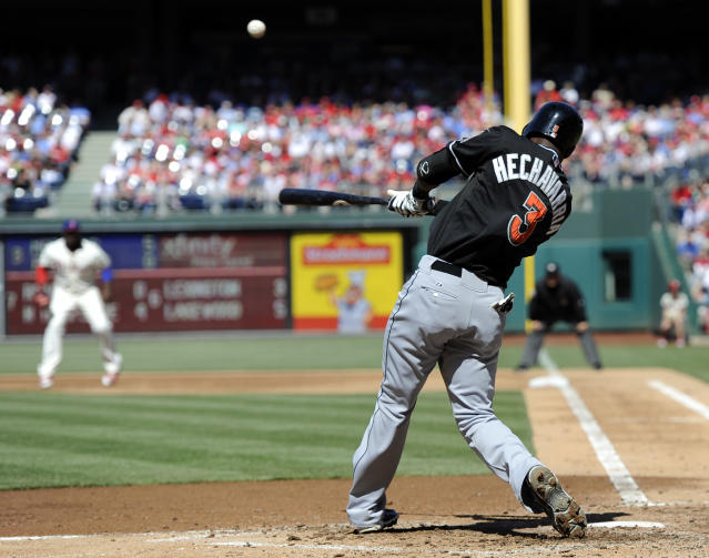 Miami Marlins' Adeiny Hechavarria (3) hits a ball to right field for a home run in the third inning of an MLB National League baseball game against the Philadelphia Phillies on Sunday, May 5, 2013, in Philadelphia. (AP Photo/Michael Perez)