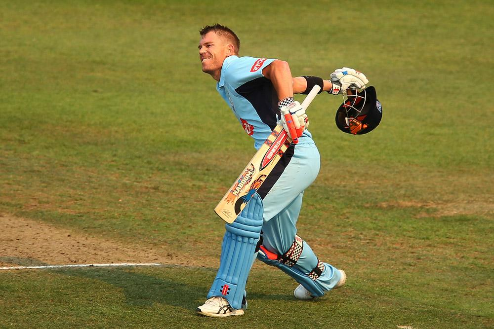 David Warner of the Blues celebrates scoring a century during the Ryobi Cup match between the New South Wales Blues and the Victorian Bushrangers at North Sydney Oval on October 20, 2013 in Sydney, Australia.  (Photo by Brendon Thorne/Getty Images)