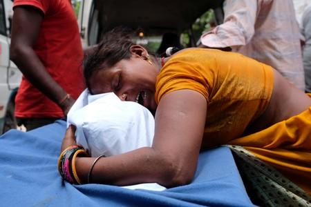A woman mourns over her daughter's body, who died of acute encephalitis, outside a hospital in Muzaffarpur