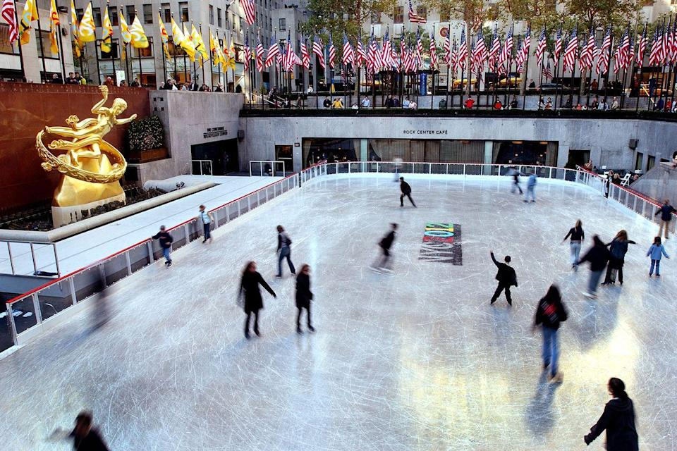 <p>Ice skaters glide around the Rockefeller Center ice skating rink on opening day October 21, 2002 in New York City.</p>