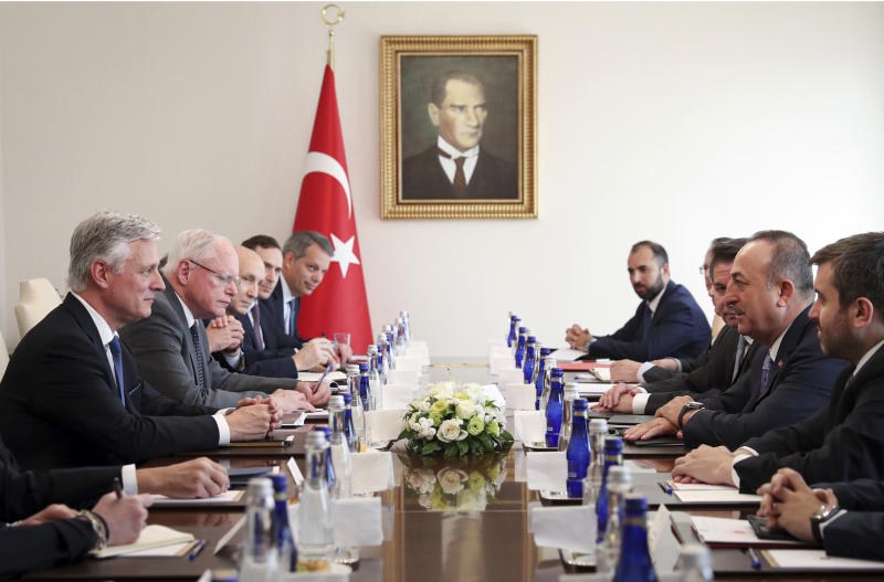 Turkish Foreign Minister Mevlut Cavusoglu, second right, and U.S. National Security Advisor Robert O'Brien attend a meeting, in Ankara, Turkey, Thursday, Oct. 17, 2019. Vice President Mike Pence, heading a U.S. delegation, is set to arrive in Ankara Thursday afternoon, a day after Trump dismissed the very crisis he sent his aides on an emergency mission to douse. (Turkish Foreign Ministry via AP, Pool)