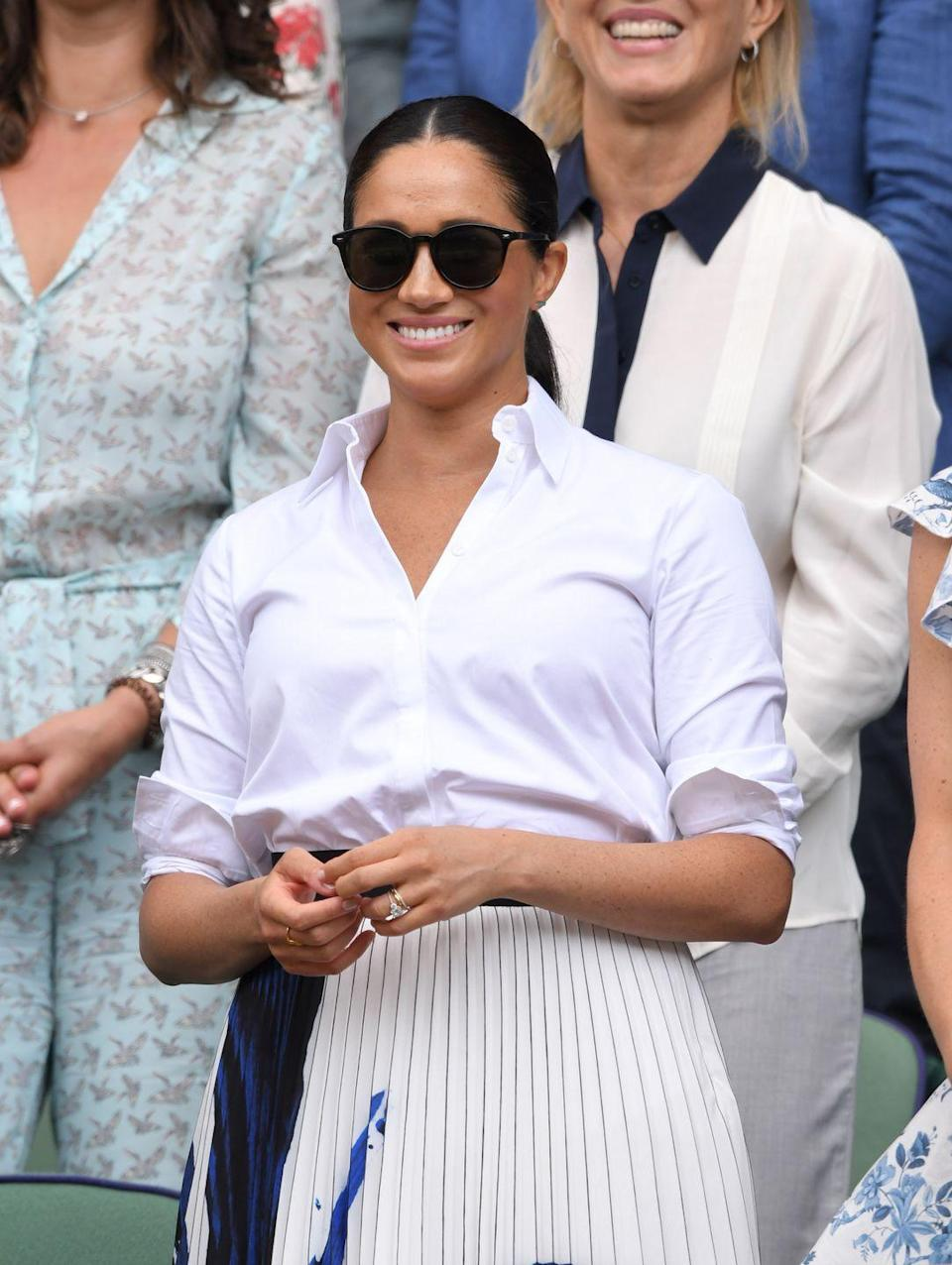 """<p>Meghan also wore a Givenchy button-down and skirt to attend Wimbledon in 2019. Shop a similar style below. </p><p><a class=""""link rapid-noclick-resp"""" href=""""https://go.redirectingat.com?id=74968X1596630&url=https%3A%2F%2Fwww.farfetch.com%2Fca%2Fshopping%2Fwomen%2Fgivenchy-bib-long-sleeved-buttoned-shirt-item-14759165.aspx%3Fstoreid%3D9910&sref=https%3A%2F%2Fwww.townandcountrymag.com%2Fsociety%2Ftradition%2Fg36386449%2Fmeghan-markle-white-button-down-shirts%2F"""" rel=""""nofollow noopener"""" target=""""_blank"""" data-ylk=""""slk:Shop now"""">Shop now</a></p>"""