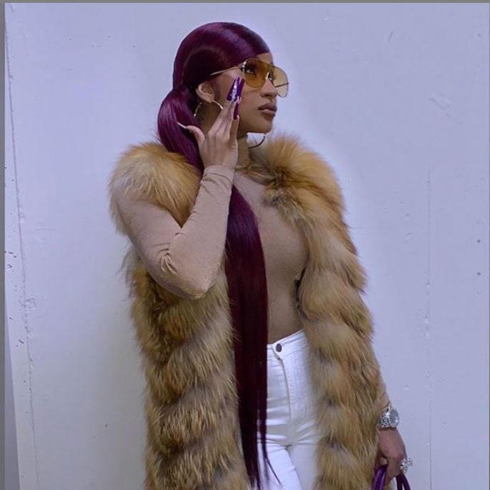 Cardi was feeling extra luxurious with her floor-length fur vest, purple Birkin bag, and lengthy ponytail at the NBA All-Star Game in February of 2020. The garnet wig was slicked back into this low, side ponytail. We need the details on the styling products ASAP because not a single hair is out of place.