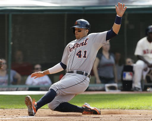 Detroit Tigers' Victor Martinez scores on a single by Detroit Tigers' Jhonny Peralta in the third inning of a baseball game against the Cleveland Indians, Saturday, July 6, 2013, in Cleveland. (AP Photo/Tony Dejak)