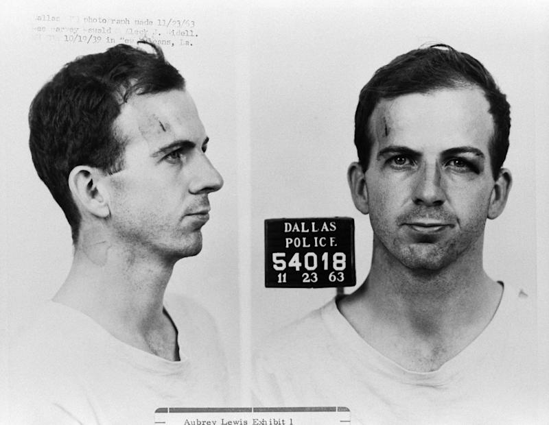Lee Harvey Oswald is seen following his arrest for possible involvement in the John F. Kennedy assassination and the murder of Officer J.D. Tippit.