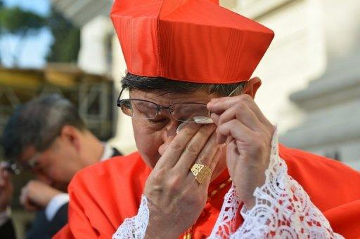 Philippines' Luis Antonio Tagle sheds a tear after being appointed a cardinal at St Peter's basilica at the Vatican on Saturday. Pope Benedict XVI on Saturday officially named six new non-European cardinals to the body that will elect his successor, saying the move underlined the Church's diversity