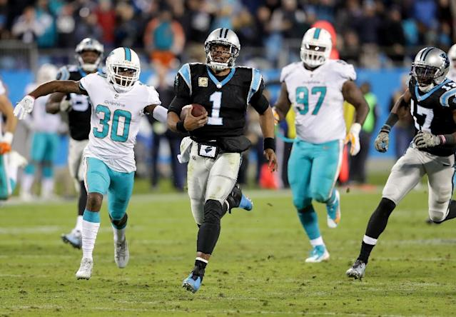 Cam Newton of the Carolina Panthers runs with the ball during their game against the Miami Dolphins, at Bank of America Stadium in Charlotte, North Carolina, on November 13, 2017 (AFP Photo/STREETER LECKA)