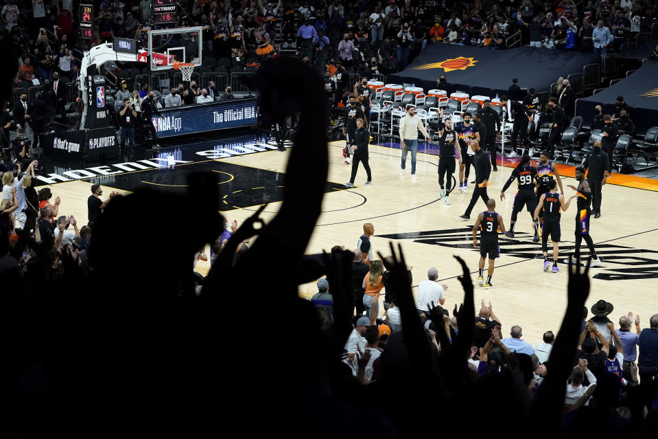 Phoenix Suns fans cheer during the second half of Game 1 of an NBA basketball second-round playoff series abasing the Denver Nuggets, Monday, June 7, 2021, in Phoenix. (AP Photo/Matt York)
