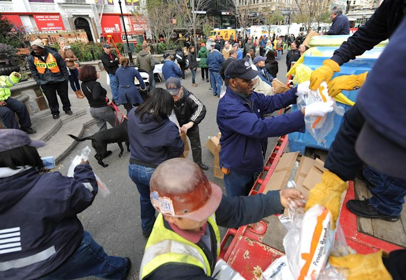 Dry ice is unloaded from a flatbed truck in Union Square for distribution to residents of the still powerless Chelsea section of Manhattan, Thursday, Nov.1, 2012, in New York. Three days after superstorm Sandy walloped the city, residents and commuters still faced obstacles as they tried to return to pre-storm routines. (AP Photo/ Louis Lanzano)