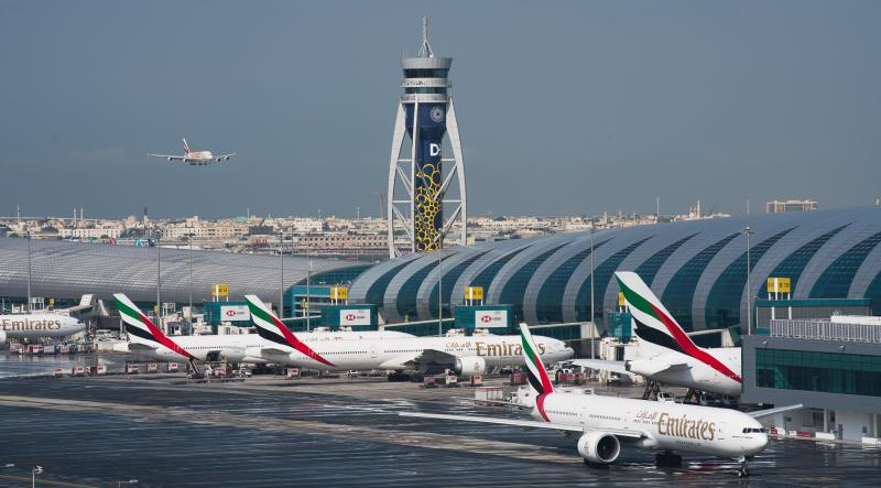 CORRECTS TO SAY THAT EMIRATES HAS DRAMATICALLY CUT ITS PASSENGER FLIGHT DESTINATIONS AND NOT SUSPENDED ALL FLIGHTS. -- FILE - In this Dec. 11, 2019 file photo, an Emirates jetliner comes in for landing at Dubai International Airport in Dubai, United Arab Emirates. On Sunday, March 22, 2020, long-haul carrier Emirates it has dramatically cut its passenger flight destinations from 145 locations to just 13 countries. (AP Photo/Jon Gambrell, File)