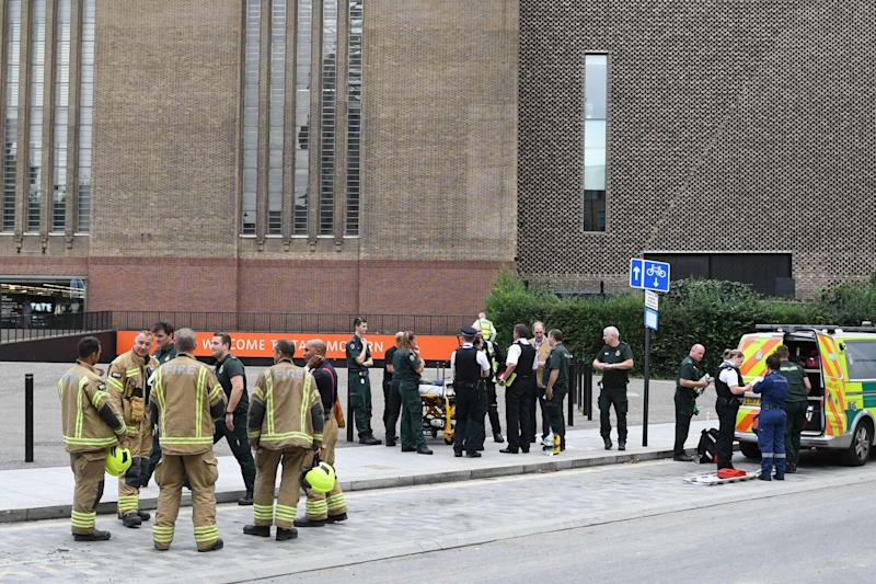 Police, ambulance crews and fire crews are seen outside the Tate Modern. (AFP/Getty Images)
