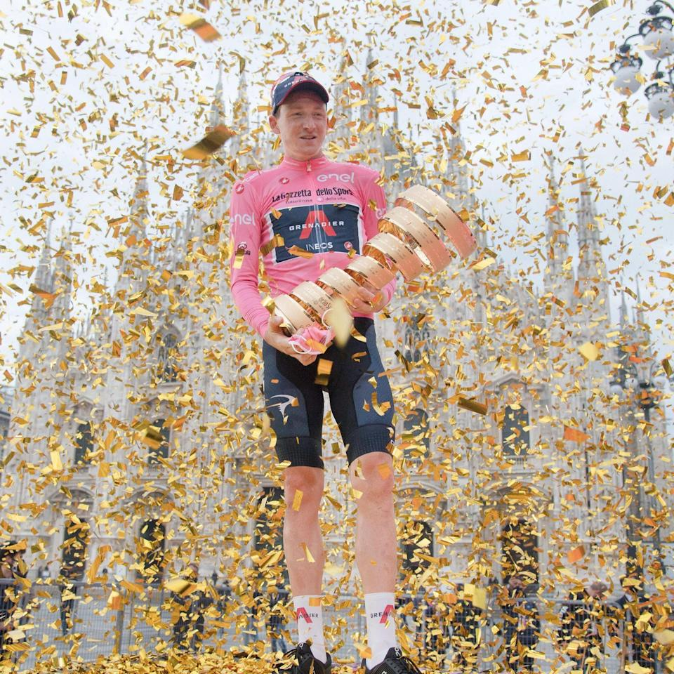 Shutterstock (10974248k) British rider Tao Geoghegan Hart of Ineos Grenadiers team celebrates with the trophy after winning the 103rd Giro d'Italia cycling race, Milano, Italy, 25 October 2020. Giro d'Italia - 21st stage, Milan, Italy - LUCA ZENNARO/EPA-EFE/Shutterstock