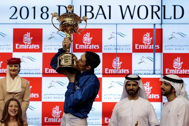 Horse Racing - Dubai World Cup 2018 - Meydan Racecourse, Dubai - United Arab Emirates - March 31, 2018 - Christophe Soumillon kisses his trophy after winning the Final Race. REUTERS/Christopher Pike