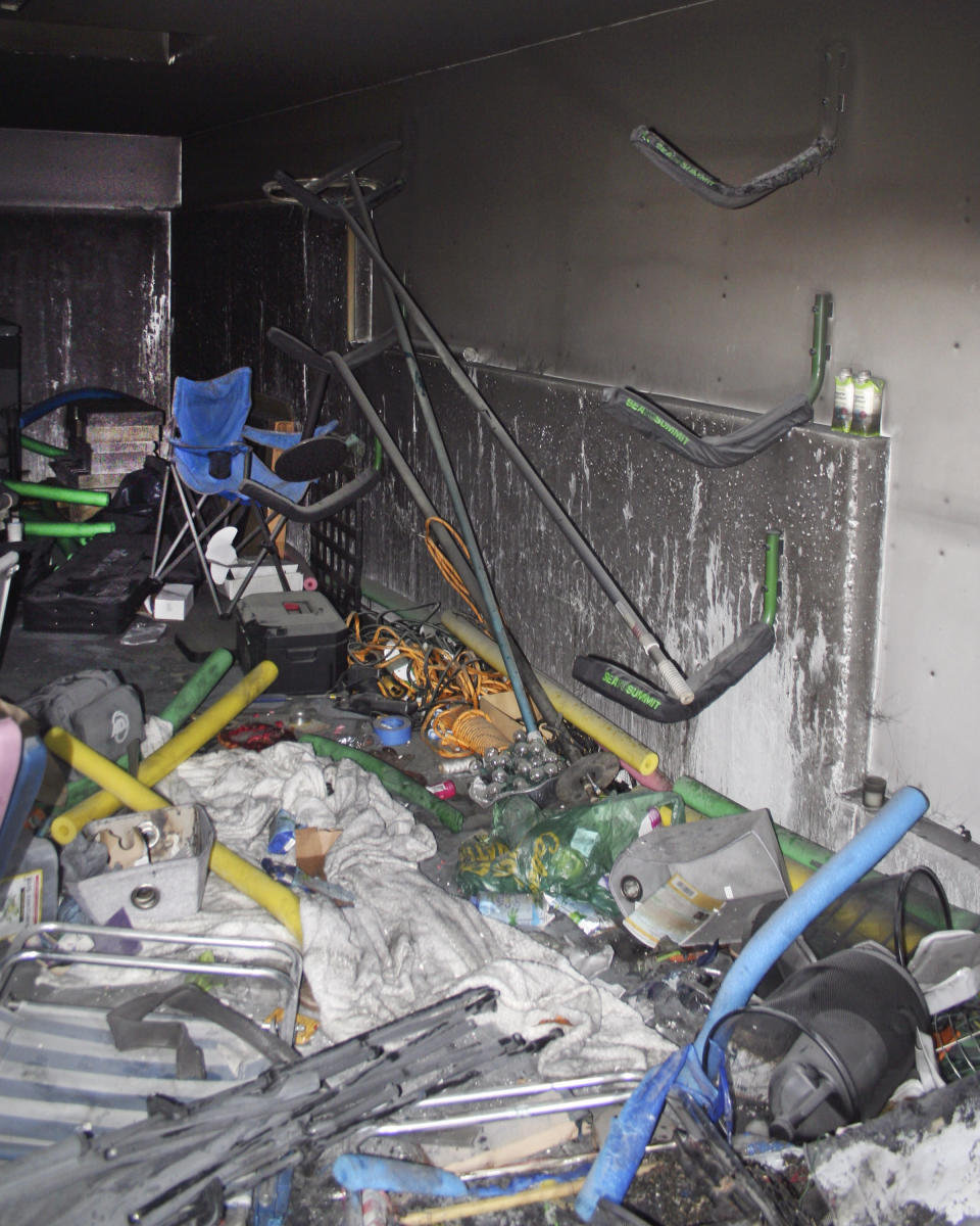 This photo, provided by the New London, Conn.,, Fire Department, shows fire damage inside a storage shed where Tony Hsieh, the retired CEO of the online shoe retailer Zappos died on Nov. 18, 2020. The cause of the fire that killed Hsieh could not be determined, a Connecticut investigator said in a report, Tuesday, Jan. 26, 2021. (New London Fire Department via AP)