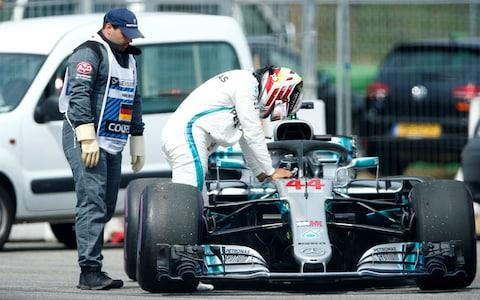Formula One F1 - German Grand Prix - Hockenheimring, Hockenheim, Germany - July 21, 2018 Mercedes' Lewis Hamilton gets out of his car during qualifying - Credit: reuters
