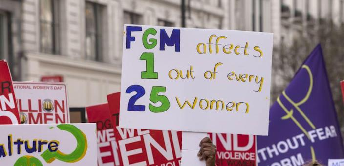 a protest sign opposing female genital mutilation