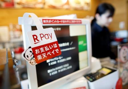 A campaign advertising of Rakuten Pay, QR code mobile payment system operated by Rakuten, is displayed at a coffee shop in Tokyo