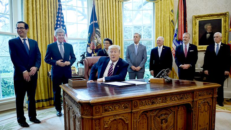 President Donald Trump prepares to sign the Paycheck Protection Program and Health Care Enhancement Act in the Oval Office of the White House in Washington, DC, on April 24, 2020. (Olivier Douliery/AFP via Getty Images)