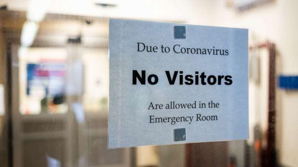 PHOTO: A sign is posted on the door of an emergency department on March 23, 2020 as coronavirus cases, and precautions, grow across the United States. (Misha Friedman/Getty Images)