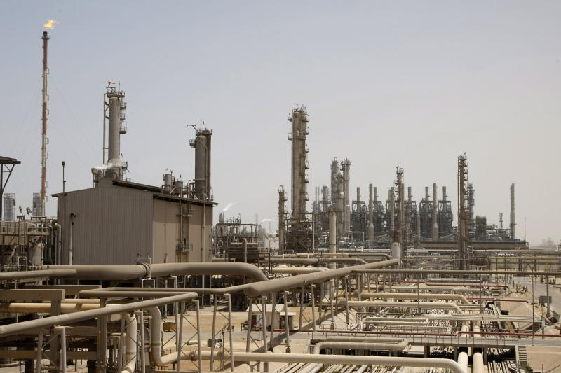 FILE - This May. 3, 2009 file photo shows an oil facility in Jubeil, about 600 kilometers (370 miles) from Riyadh, Saudi Arabia.  Saudi Arabia formally started its long-anticipated initial public offering of its state-run oil giant Saudi Aramco on Sunday, which will see a sliver of the firm offered on a local stock exchange in hopes of raising billions of dollars for the kingdom. (AP Photo/Hassan Ammar, File)