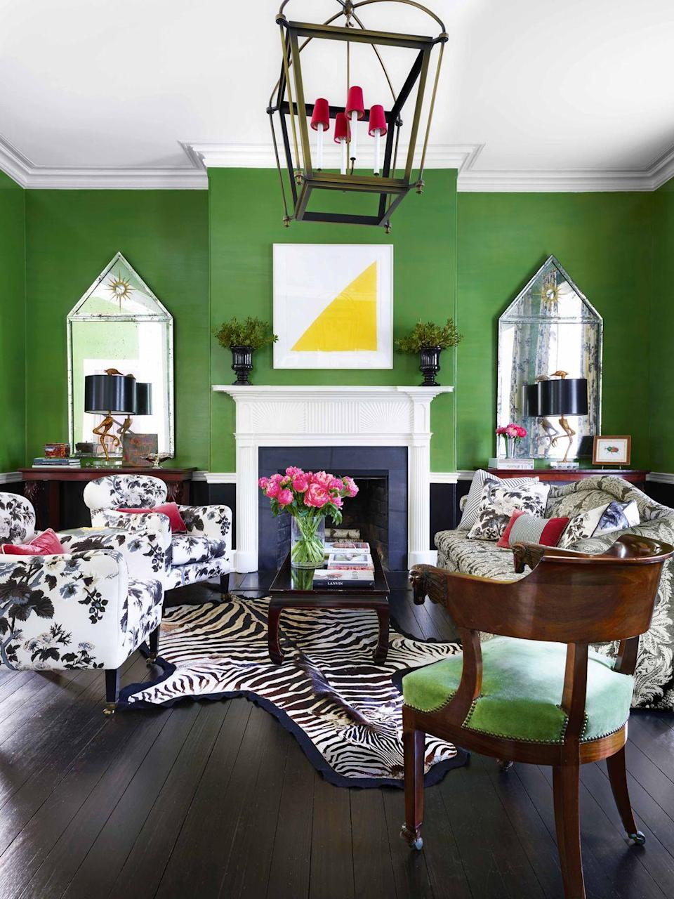 "<p>Black and white patterns pop against vivid green lacquered walls in this Washington D.C. living room by designer <a href=""https://branca.com"" rel=""nofollow noopener"" target=""_blank"" data-ylk=""slk:Alessandra Branca"" class=""link rapid-noclick-resp"">Alessandra Branca</a>. The sofa and chairs are covered in a <a href=""https://fschumacher.com"" rel=""nofollow noopener"" target=""_blank"" data-ylk=""slk:Schumacher"" class=""link rapid-noclick-resp"">Schumacher</a> fabric. The artwork is by Ellsworth Kelly. </p><p><a class=""link rapid-noclick-resp"" href=""https://www.sherwin-williams.com/homeowners/color/find-and-explore-colors/paint-colors-by-family/SW6924-direct-green"" rel=""nofollow noopener"" target=""_blank"" data-ylk=""slk:Get the Look"">Get the Look</a></p>"