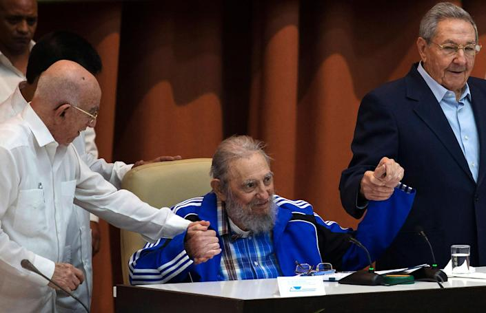 <p>APR. 19, 2016 — Fidel Castro sits as he clasps hands with his brother, Cuban President Raul Castro, right, and second secretary of the Central Committee, Jose Ramon Machado Ventura, moments before the playing of the Communist party hymn during the closing ceremonies of the 7th Congress of the Cuban Communist Party, in Havana, Cuba. (Ismael Francisco/Cubadebate via AP) </p>