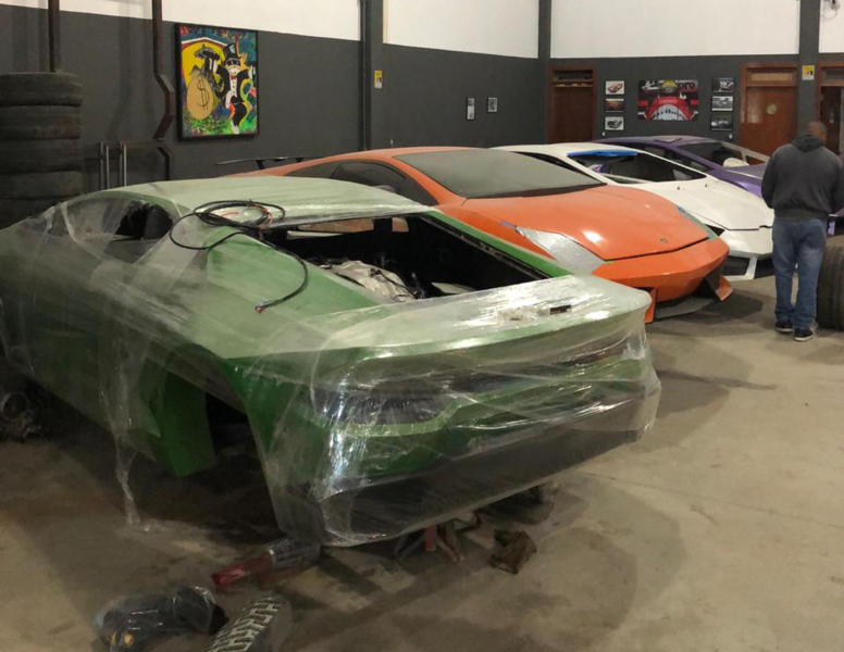 This July 15, 2019 photo released by Itajai Civil Police, shows car molds of luxury car replicas at a workshop in Itajai, Brazil. Brazilian police dismantled a clandestine workshop run by a father and son who assembled fake Ferraris and Lamborghinis to order, in Brazil's southern state of Santa Catarina. (Itajai Civil Police via AP)