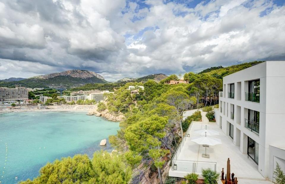 """<p>Dreaming of somewhere sunnier? This pretty villa, which has direct access to the sea, is what dreams are made of. Inside you'll find a light-flooded living room, practical <a href=""""https://www.housebeautiful.com/uk/decorate/kitchen/g35138029/kitchen-cupboard-paint/"""" rel=""""nofollow noopener"""" target=""""_blank"""" data-ylk=""""slk:kitchen"""" class=""""link rapid-noclick-resp"""">kitchen</a>, nine large bedrooms, sauna, indoor pool, and a sprawling rooftop terrace too. Why not take a peek...</p><p><a href=""""https://www.rightmove.co.uk/properties/86279923"""" rel=""""nofollow noopener"""" target=""""_blank"""" data-ylk=""""slk:This property is currently on the market for £13,054,050 with Kensington International via Rightmove."""" class=""""link rapid-noclick-resp"""">This property is currently on the market for £13,054,050 with Kensington International via Rightmove.</a><br></p>"""