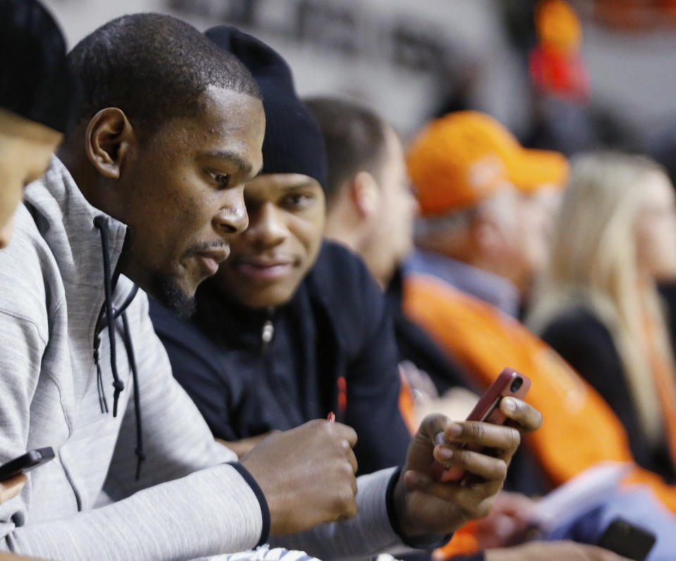 """Maybe <a class=""""link rapid-noclick-resp"""" href=""""/nba/players/4390/"""" data-ylk=""""slk:Russell Westbrook"""">Russell Westbrook</a> knows <a class=""""link rapid-noclick-resp"""" href=""""/nba/players/4244/"""" data-ylk=""""slk:Kevin Durant"""">Kevin Durant</a>'s alternate Twitter identity. (AP)"""